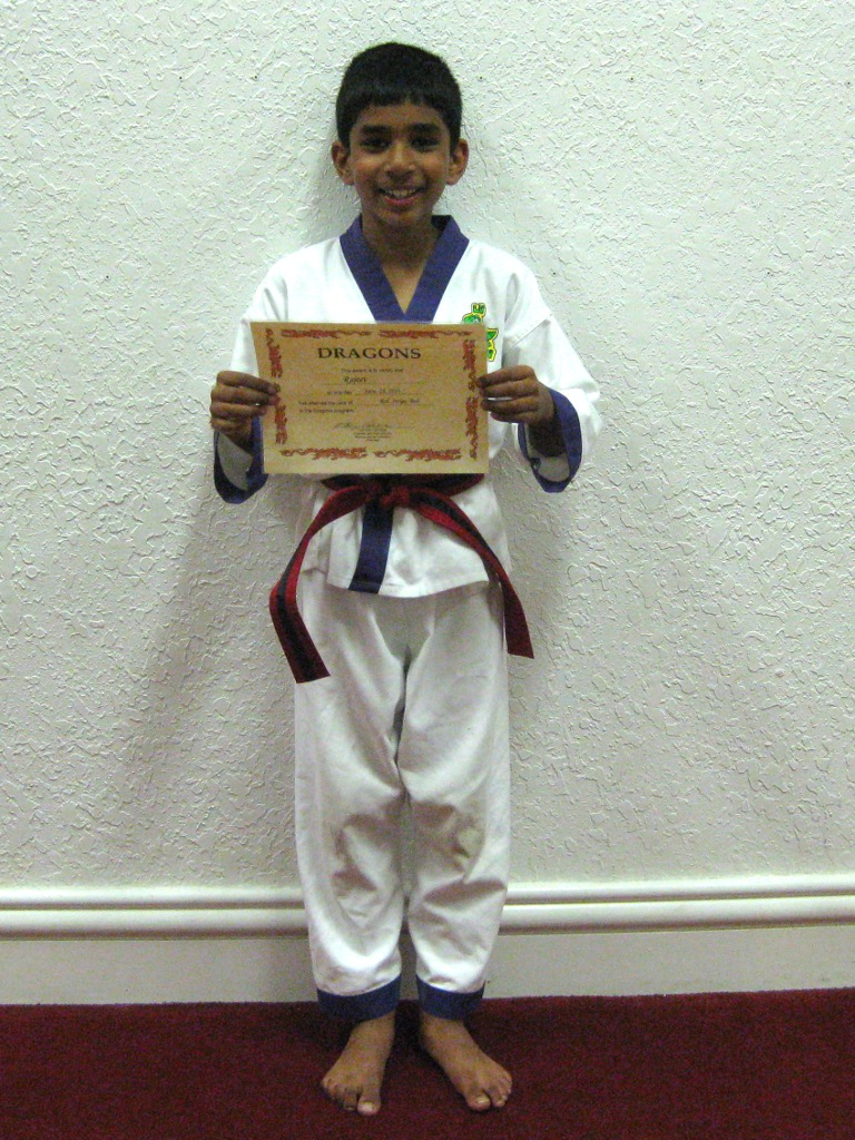 Rajeev with newly awarded certificate for red striped belt