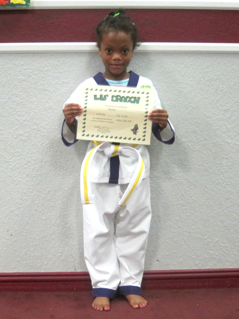 Malise with newly awarded certificate for yellow stripe belt