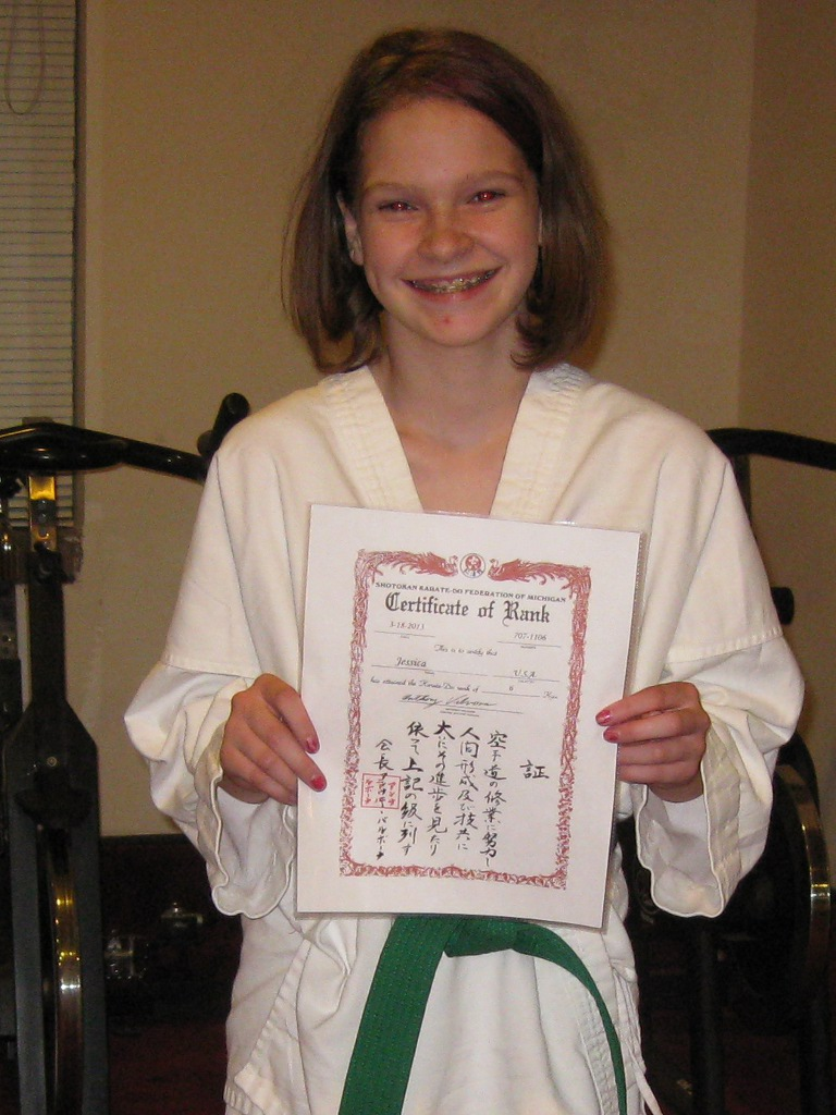 Jessica with newly awarded certificate for green belt
